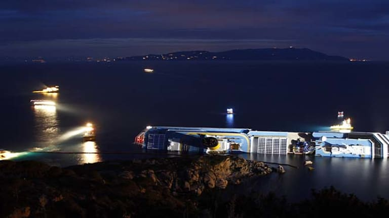 Disaster... The Costa Concordia lies on its side.