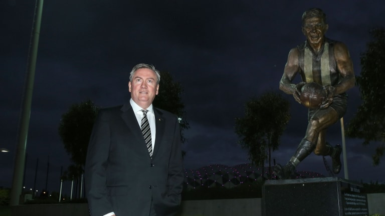 Collingwood President Eddie McGuire at the Lou Richards statue at Collingwood Football Club.