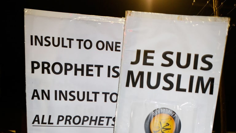 Children hold placards during the rally to show their support for the Prophet Muhammad.