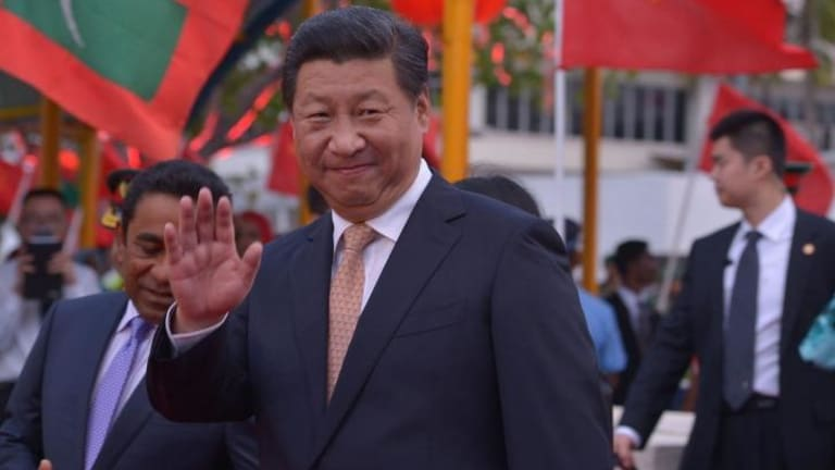 President Xi Jinping arrives in the Maldives, where he told Chinese tourists to eat less instant noodles and more local seafood.
