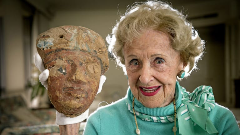 Real ilfe tomb raider Joan Howard pictured with a mummy mask she found at Sakkara, the necropolis for the ancient Egyptian capital Memphis.