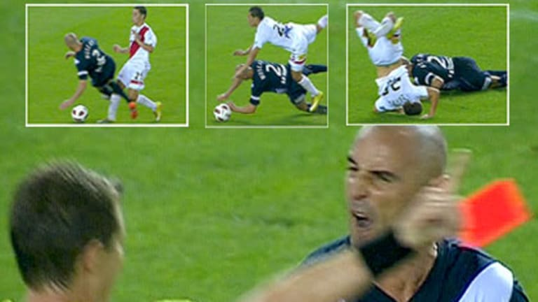 Muscat crunches Zahra then gives the referee a spray as he is sent from the field.