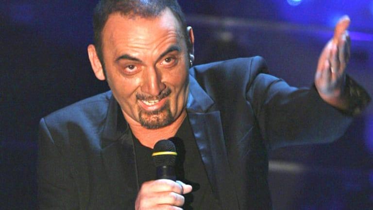 Collapsed on stage ... 60-year-old Italian singer Giuseppe Mango.