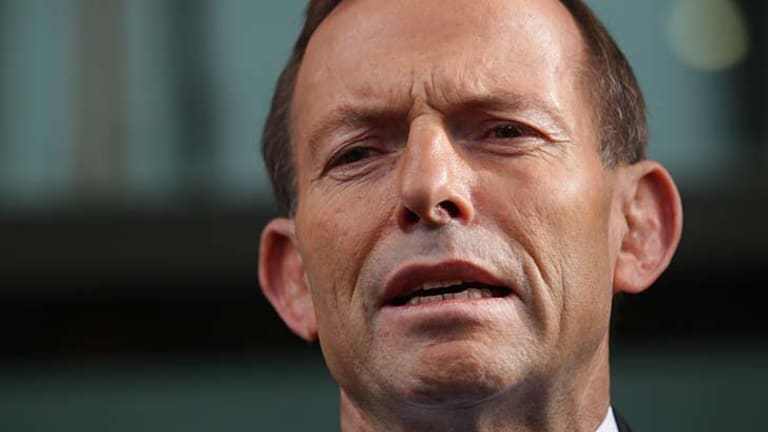 Tony Abbott: accused of physically intimidating a woman.