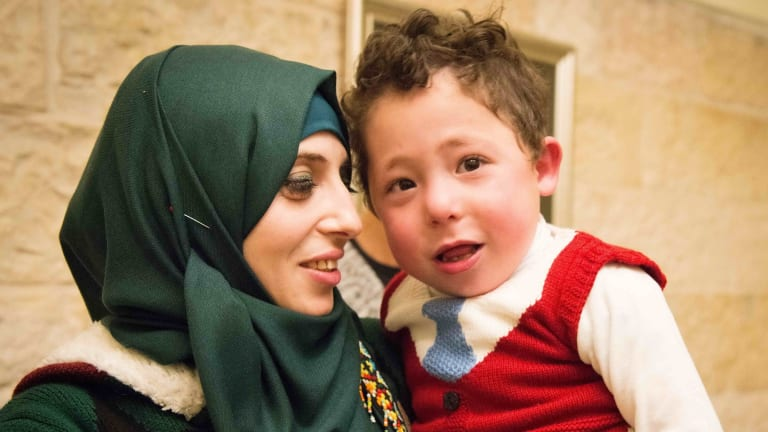 A Palestinian mother with her child being treated at an Israeli hospital through Project Rozana.