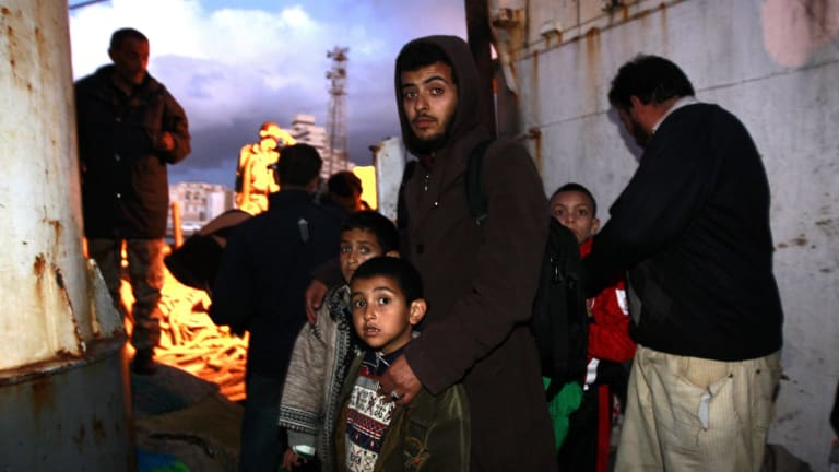 Libyans wait to be evacuated from the fighting engulfing their country in 2011.
