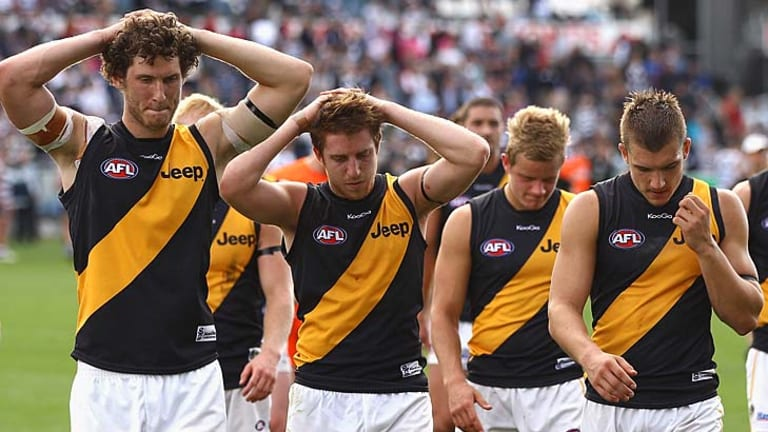 A dejected Tigers outfit leaves the ground.