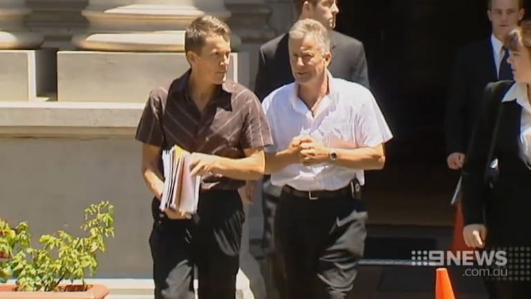 Peter and Ray Mickelberg exit court after another battle.