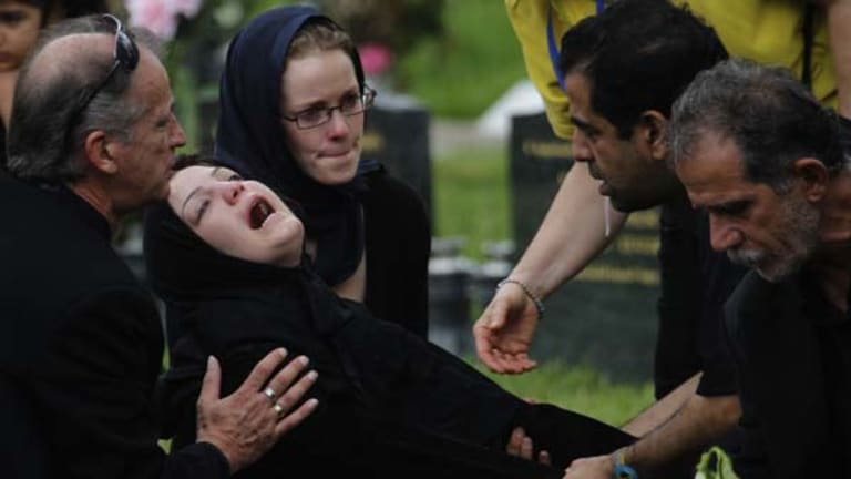 Overwhelmed ... Fatema, whose brother was being buried. She is the aunt of Sinan. Fatema's sister is still missing at sea.