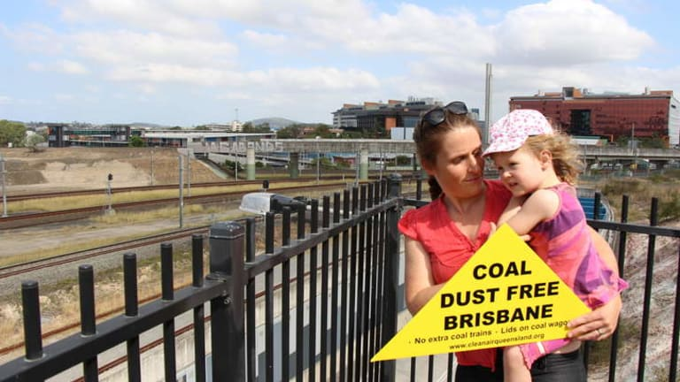 Marnie and Indigo Cotton protest the uncovered coal trains in Brisbane.