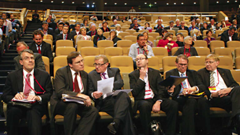 Stripped-down, pared-back, deliberately drab  ... Simon Crean, third from left, talks to the ALP national conference delegate Gerard Dwyer in Sydney yesterday.