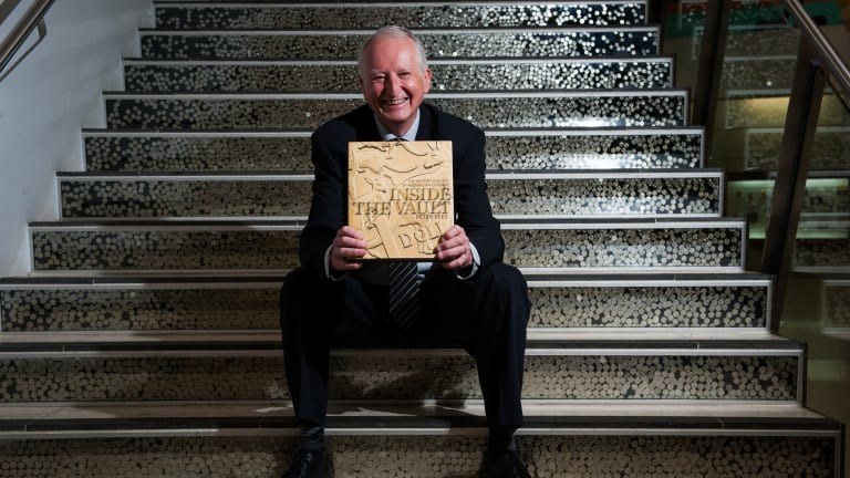 Canberra author Peter Rees at the Royal Australian Mint with his book Inside the Vault: The history and art of Australian coinage.