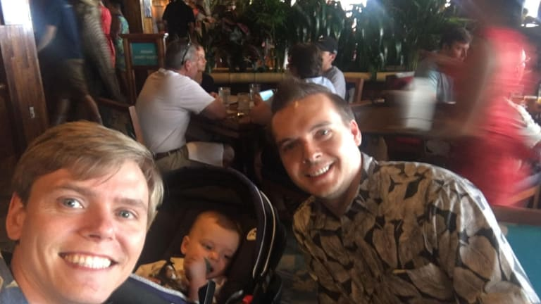 Kyle (left) and Kent Stewart with their son Kaden.