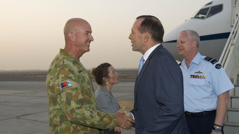 Major-General Craig Orme greets Prime Minister Tony Abbott as he arrives at Al Minhad Air Base, United Arab Emirates.