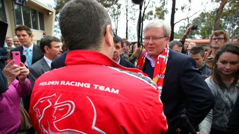 Prime Minister Kevin Rudd meets Holden workers at a barbecue in Adelaide after announcing extra funding for the car industry.
