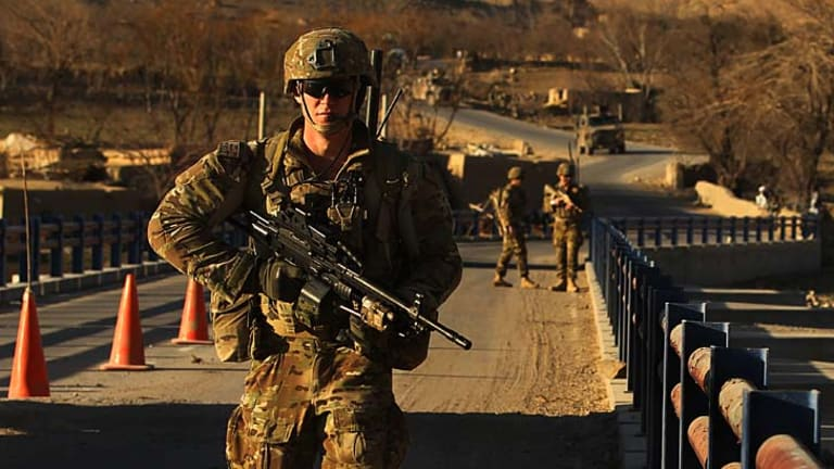 Vigilant: Australian soldiers patrol and search the Puza bridge in Oruzgan province for improvised explosive devices after an insurgent was arrested there the previous night with explosives.