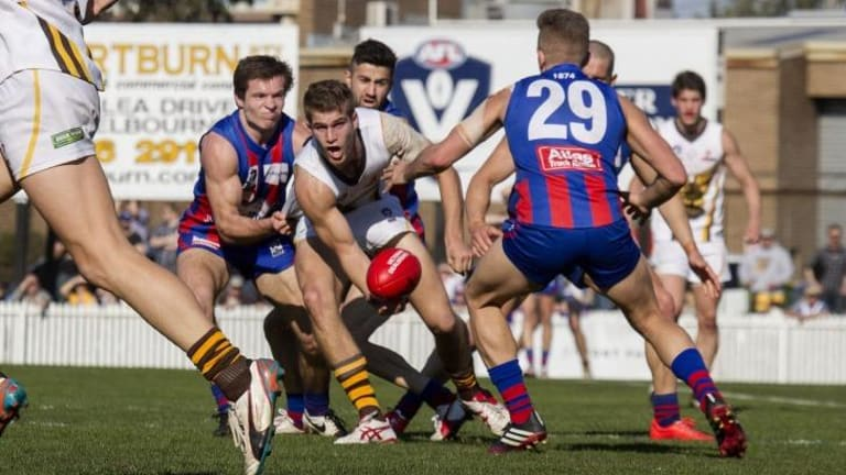 Box Hill's Jordan Kelly is tackled in the qualifying final against Port Melbourne at North Port Oval.