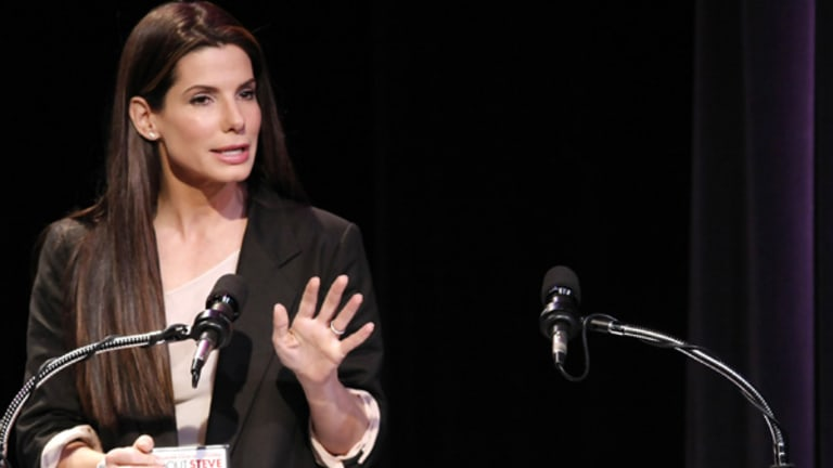 Actress Sandra Bullock accepts her Razzie award for worst actress in a feature film in Los Angeles.