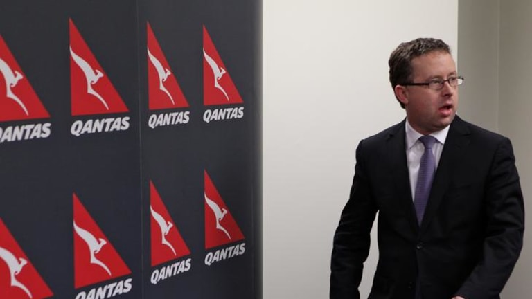 Qantas CEO Alan Joyce holds a media conference to announce the grounding of all flights.