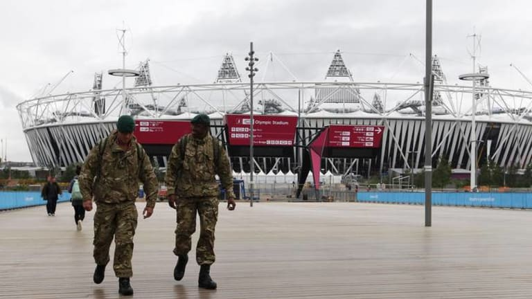 Call in the troops ... two soldiers walk through the Olympic Park.