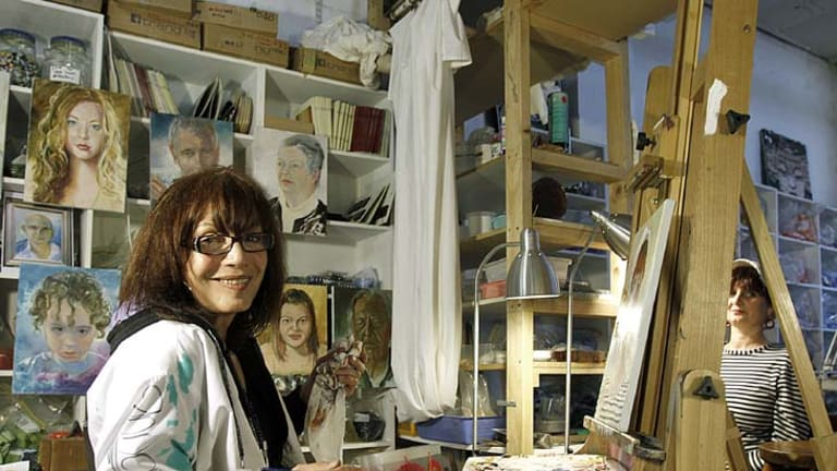 Archibald finalist Anna Minardo in her Windsor studio, painting one of 196 portraits for a portrait marathon to raise money for multiple sclerosis.
