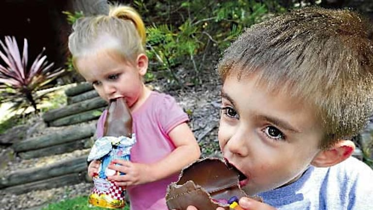 The ultimate test... Lucy Brown, 2, and big brother Noah, 4, tuck into some easter eggs at their Blue Mountains home.