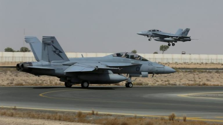 An RAAF fighter jet has bombed a building used by the Islamic State as a command centre, marking the first time Australia's air force has fired on an enemy since 2003.