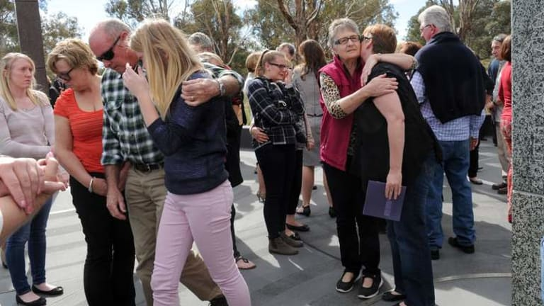 People gather to remember relatives and friends during the ceremony.