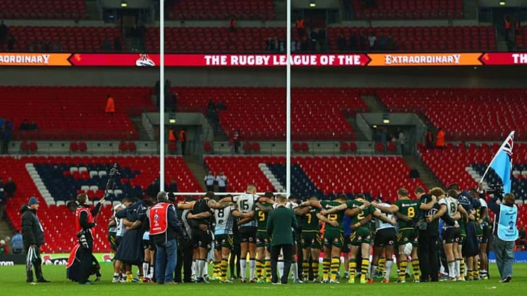 Not just the faithful: Players from Australia and Fiji gather in the centre of the field to pray after their World Cup semi-final at Wembley Stadium.
