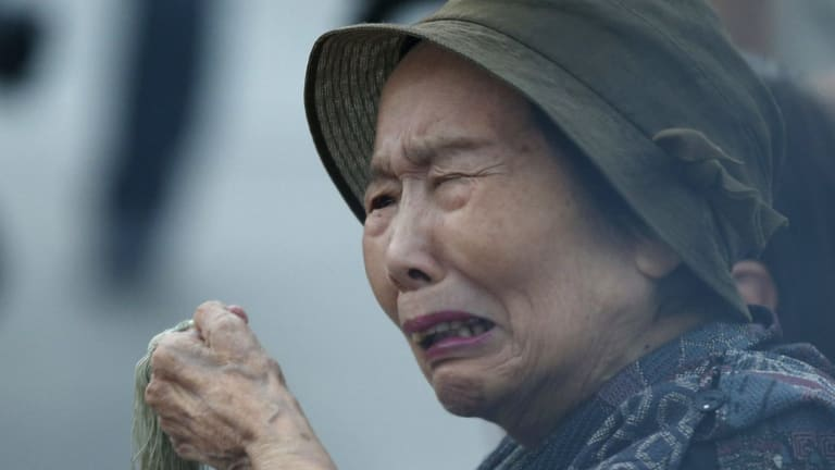 A woman prays for the atomic bomb victims in front of the cenotaph for the victims of the 1945 atomic bombing, at Peace Memorial Park in Hiroshima, western Japan, on Thursday.