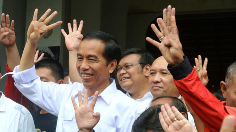 """Hands-on approach: Joko """"Jokowi"""" Widodo shows the number-four position of his PDI-P party on the ballot paper in this April's parliamentary elections."""