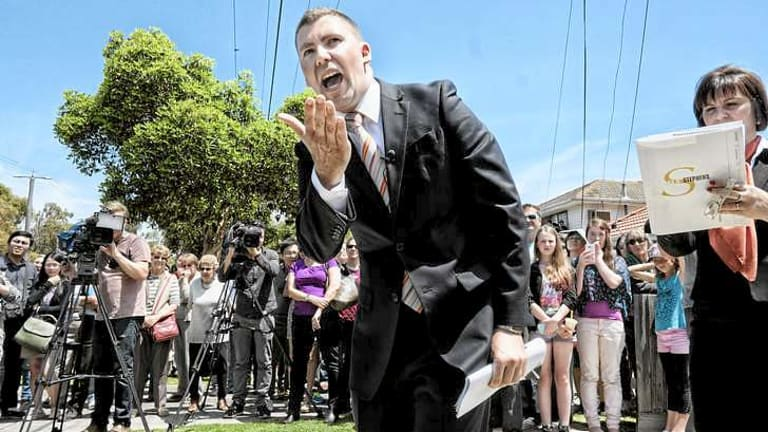 The auctioneer at work at Gillard's house.