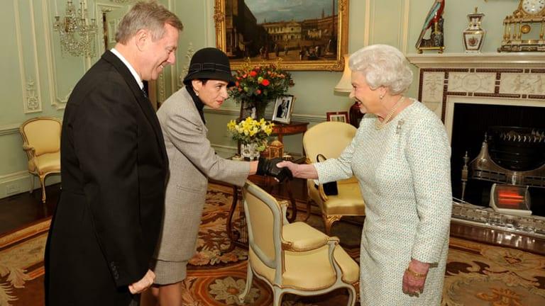 Queen Elizabeth Ii Shakes Hands With Sasha Rann As Her Husband High Commissioner Of Australia Mr
