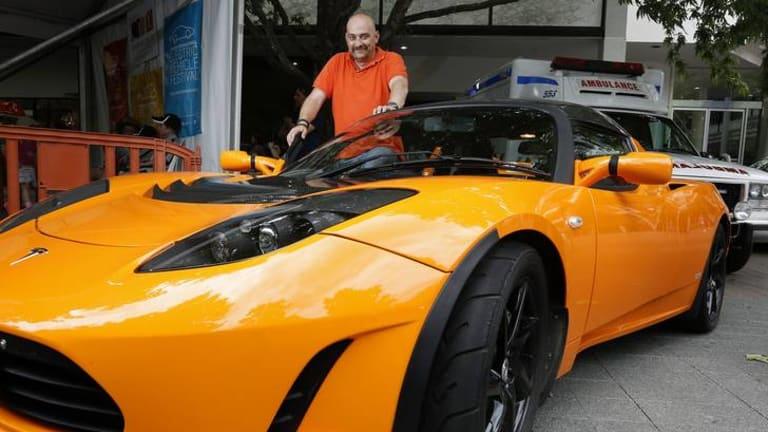 John Efkarpidis from Googong with his Tesla Roadster Sports electric car.