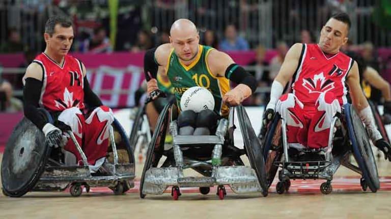 Chris Bond of Australia breaks through the Canada defence.