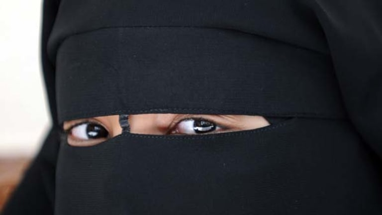 Banned ... A Muslim woman wearing the niqab just outside of Paris.