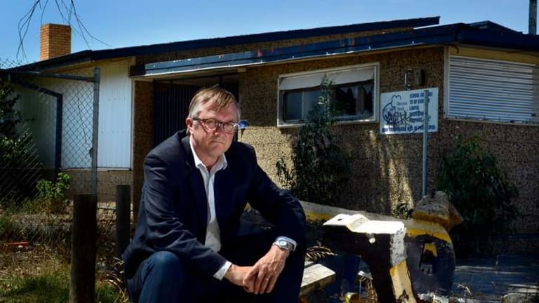 Dennis Glover outside his old school, Doveton North Primary, which is now closed.