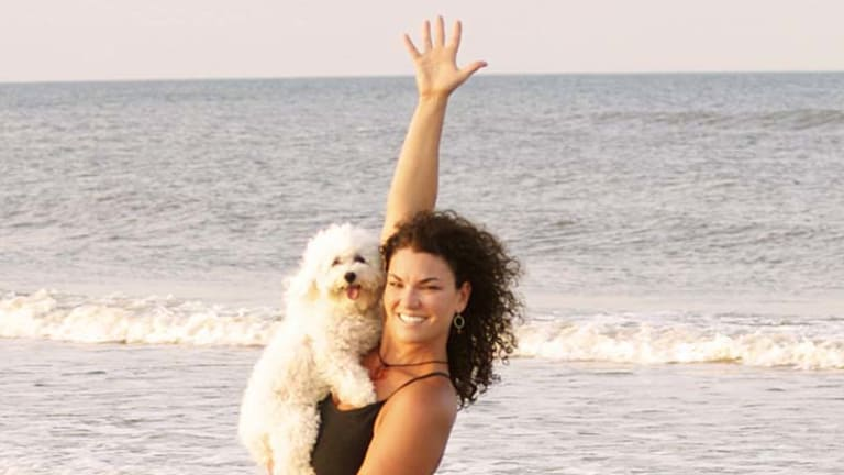 Doga instructor Suzi Teitelman and dog Roxy  in a warrior pose at Ponte Vedra Beach, Florida.