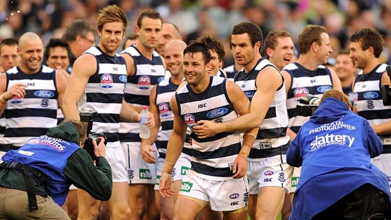 Finest feline: Geelong's Jimmy Bartel (centre) is congratulated by teammates after winning the Norm Smith Medal.