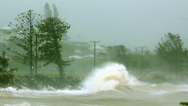 Waves crash into a breakwall after Tropical Cyclone Marcia made landfall near Yeppoon.