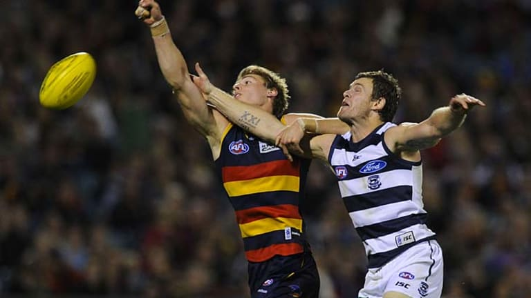Cameron Mooney, right, and Daniel Talia during Geelong's 11-point win over Adelaide.