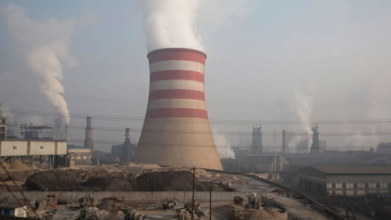 Smoke spews from the sprawling complex that is a part of the Jiujiang steel and rolling mills in Qianan in northern China's Hebei province.