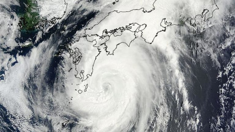 This image taken by NASA's Terra satellite shows Typhoon Halong in the Pacific Ocean, approaching Japan's main islands. Authorities ordered 1.6 million people out of the path of the storm that battered the west of the country.