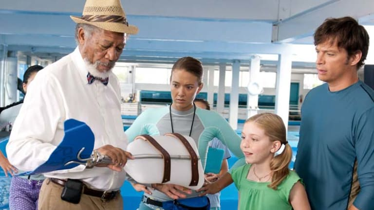 One-off design … Morgan Freeman, centre, and Harry Connick Jr, right, in <em>Dolphin Tale.</em> Freeman's character was based on two real-life prosthetic experts.