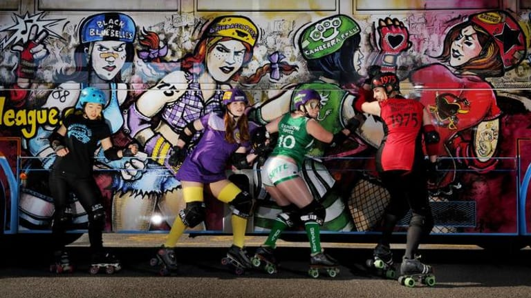 Roller gals at the Woden bus interchange, from left, Short Stop (Christine Murray), Freudian Slit (Alix Foley), Rainbow Spite (Larissa Wood) and Bohemeth Rhapsody (Thea Van Veen).