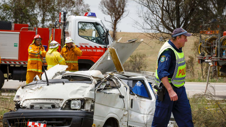 Emergency services personnel attend a crash scene on the Hume Highway near Oolong where a female driver of a van died on Thursday morning after accidentally clipping a truck.