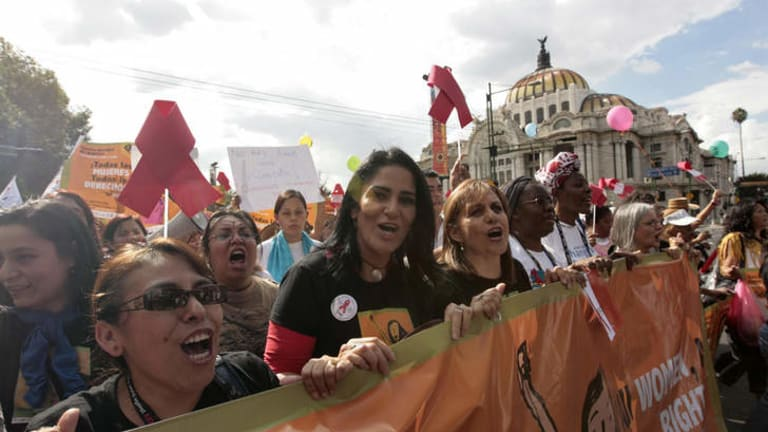 On the march: Lydia Cacho (front, second from left) holds a banner with other female activists during a demonstration in Mexico City in 2008.