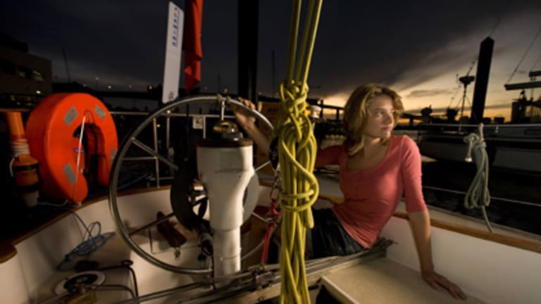Fifteen-year-old Queensland schoolgirl Jessica Watson poses on her yacht at the Rivergate Marina and Shipyard near Brisbane.
