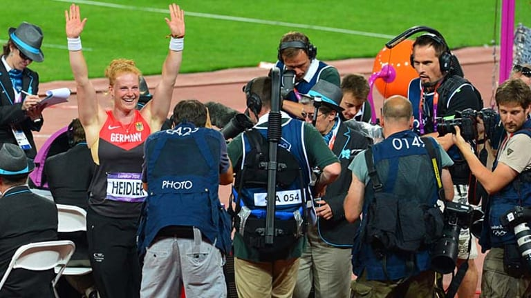 All's well that ends well ... Germany's bronze medalist Betty Heidler celebrates her medal.