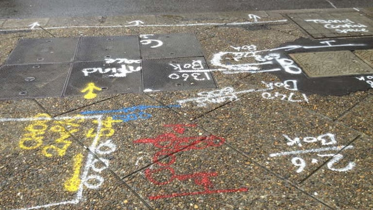 Ground-level graffiti: some of the markings seen on Sydney streets.